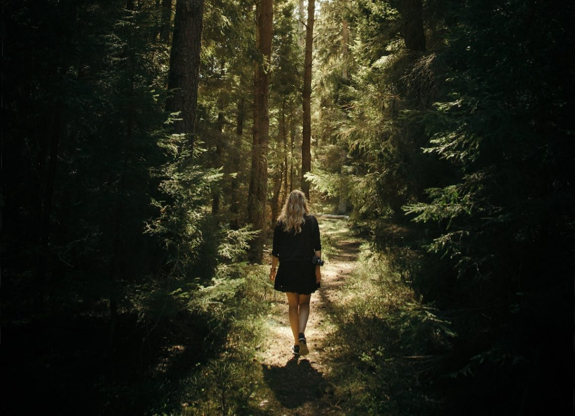 Woman walking through a forest