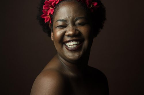 Woman smiling with flowers in her hair